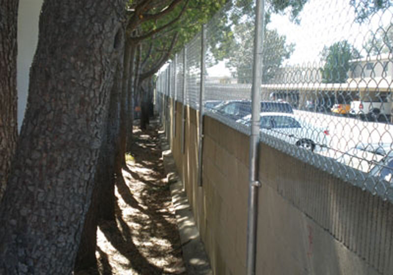 Chain Link Fence Bolted To Blockwall