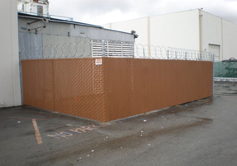 Brea Industrial - Chain-Link Slatted Fence With Razor Wire