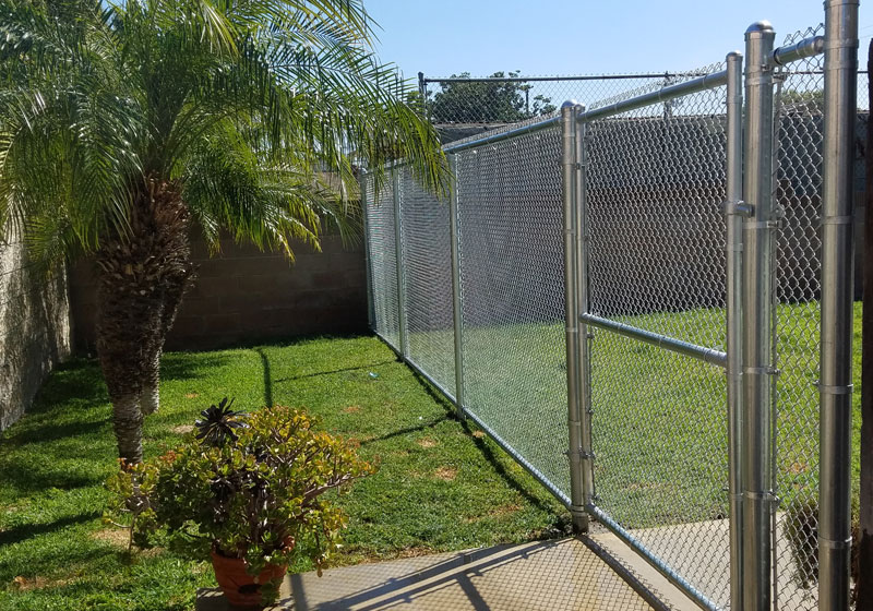 Chain link dog run in Garden Grove, CA